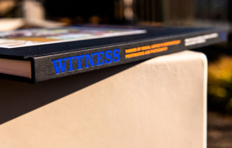 Photograph of Witness: Themes of Social Justice in Contemporary Printmaking and Photography book spine lying on its side