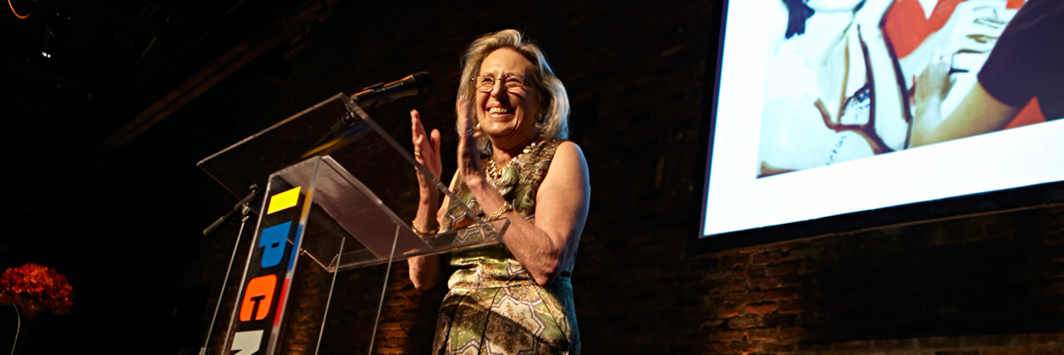 Anne Coffin, IPCNY Founding Director, stands at the podium at the 2014 IPCNY Spring Benefit