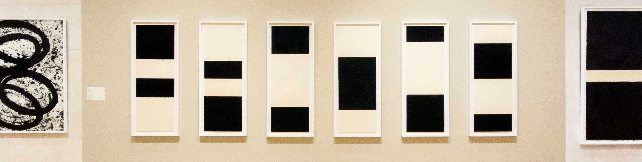 Richard Serra works in black and white hanging on a white gallery wall